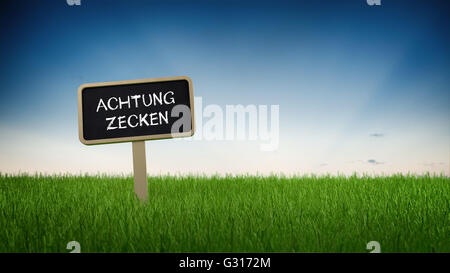 Low level perspective on German language tick warning sign stuck in turf grass with clear blue sky background - Stock Photo
