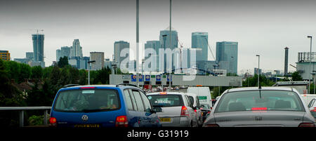 London England UK. Heavy traffic on the A2 road entering London towards Blackwall Tunnel showing Canary Wharf development - Stock Photo