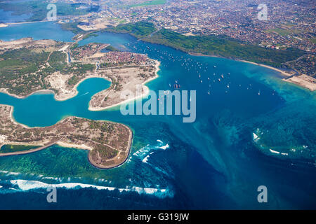 Aerial photo of Pulau Serangan ( turtle island ) with sand beach, surfing spots, sailing yacht and fisher boats - Stock Photo