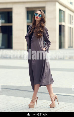Stylish woman walking in the city - Stock Photo