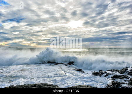 Sunrise over Kiama Rock Pool during a severe storm, Illawarra Coastline, New South Wales, Australia - Stock Photo