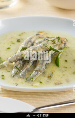 A plate of marinated anchovies - Stock Photo
