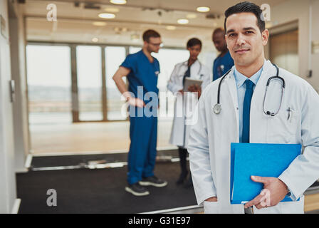 Doctor at hospital standing in front of team of surgeons and doctors, Medical Crew - Stock Photo