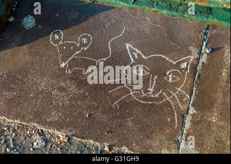 Child's chalk drawing on pavement, cat and mouse - Stock Photo