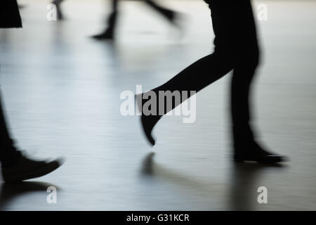 Berlin, Germany, running legs in different directions - Stock Photo