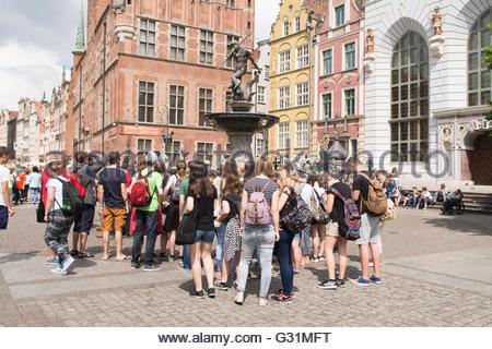 students gathered around Neptunes Fountain, Gdansk, Poland, Europe - Stock Photo