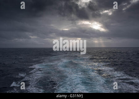 Denmark, Wake behind a ferryboat of Smyril Line in the North Atlantic - Stock Photo