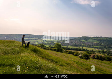 Batheaston, Somerset, UK weather. 6th June 2016. A dog walker takes in the view from atop the old Iron Age fort - Stock Photo