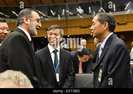 Vienna, Austria. 6th June, 2016. Wang Yiren (R), member of the board of governors of the International Atomic Energy - Stock Photo