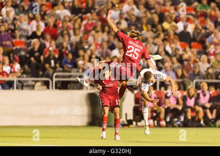 June 01, 2016: Ottawa Fury FC Lance Rozeboom (25), Carl Haworth (17) and Vancouver Whitecaps Cole Seiler (14) in - Stock Photo