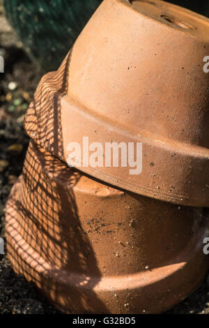 Stack of Terracotta Pots with Shadow - Stock Photo