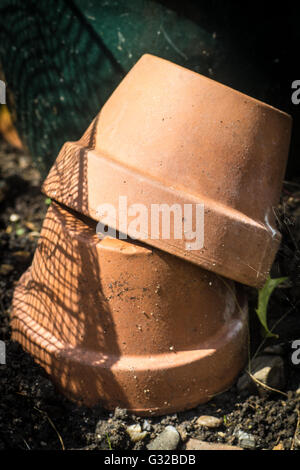 Two upturned Terracotta Pots - Stock Photo