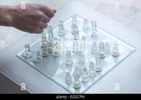 Glass Chess Pieces on a Frosted Glass Chess Board - Stock Photo