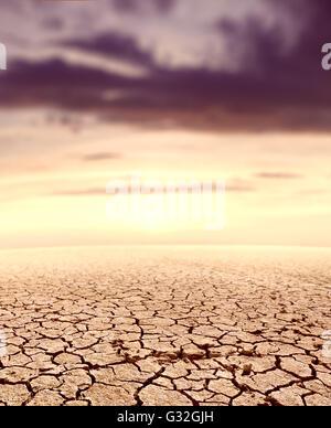 Desert landscape and sunset.ground cracked soil - Stock Photo