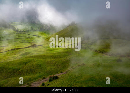 Misty view over the countryside of Sao Miguel, The Azores, Portugal - Stock Photo