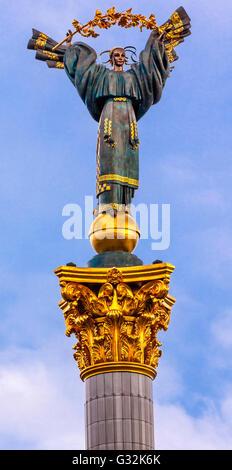 Peasant Girl Slavic Goddess Berehynia on top Independence Monument, Symbol of Ukraine Independence and Orange Revolution, - Stock Photo