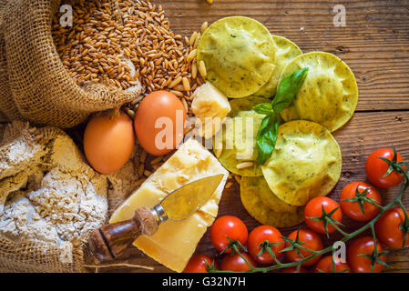 Dumplings / ravioli with cheese, basil and pine nuts, pesto. Pasta with integral flour. - Stock Photo