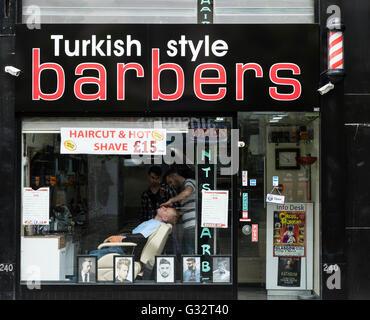 Turkish style Barber shop on Sauchiehall Street in Glasgow, Scotland, United Kingdom - Stock Photo