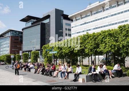 Office workers on lunch break at IFSD  Broomielaw new business and financial district in Glasgow United Kingdom - Stock Photo
