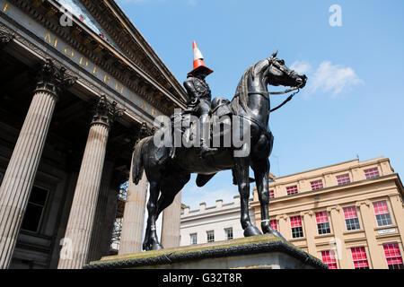 Duke of Wellington Statue with traffic cone on head outside Museum of Modern Art  in Glasgow, Scotland, United Kingdom - Stock Photo