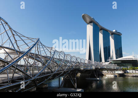 The Helix bridge, the world's first curved double helix bridge and Marina Bay Sands Hotel, Singapore - Stock Photo