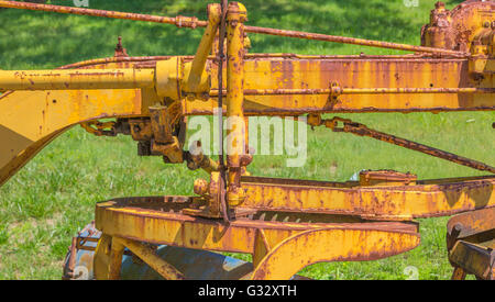 Hydraulic road grader detail, a heavy construction piece of equipment a detail image - Stock Photo