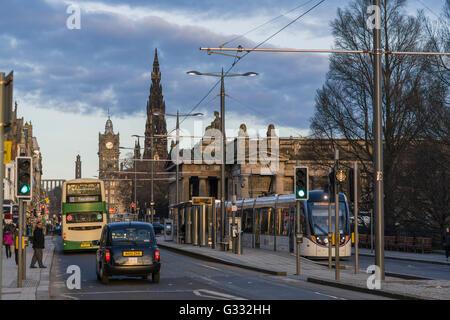 Princes Street, Edinburgh - commuter and shopper transport tram, bus, taxi - Stock Photo