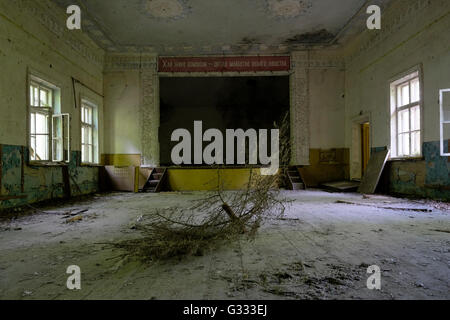 An abandoned culture house in Zalissya village located inside the Chernobyl Exclusion Zone in Ukraine on 04 June - Stock Photo