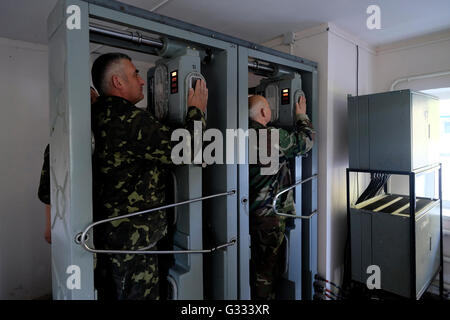Ukrainian soldiers undergo a radiation control after they leave the contaminated area at the Chernobyl nuclear site - Stock Photo