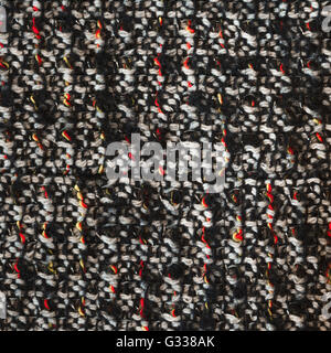 Bottle green woven woolen fabric texture. Black, white, red, yellow complicated melange. Close up fragment of the - Stock Photo