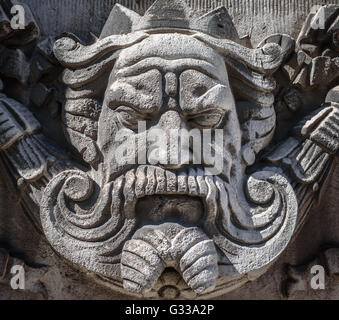 The face of a king carved in stone on the facade of a building in Liverpool. - Stock Photo