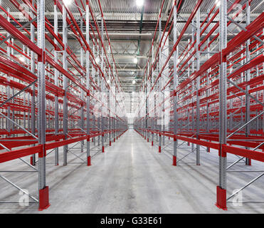 Industrial racks pallets shelves in huge empty warehouse interior.  Storage equipment. - Stock Photo