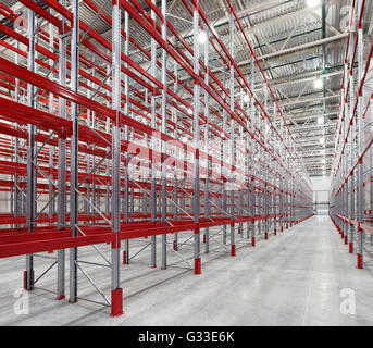 Racks pallets shelves in huge empty warehouse interior. Storage equipment. - Stock Photo