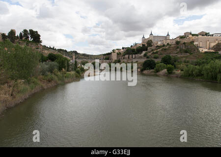 Tagus river with view of bridge  Puente de alcantara in Toledo, Spain - Stock Photo