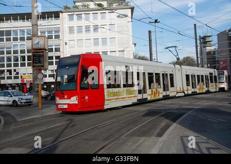 A low floor tram operated by Kölner Verkehrs-Betriebe AG (KVB) arrives at Neumarkt in Köln (Cologne) Germany - Stock Photo