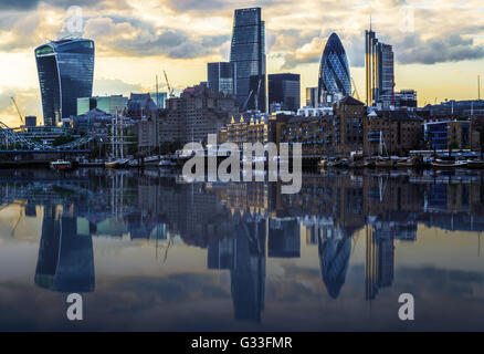 London cityscape during sunset with its reflection from river Thames - Stock Photo