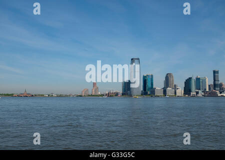 The skyline of lower downtown Manhattan, New York City, featuring the new One World Trade Center by architect David - Stock Photo