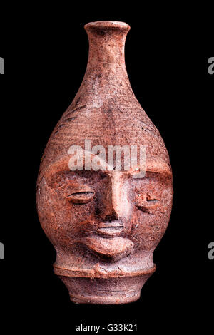 An Ancient Terracotta Vase Or Jug Shaped Like A Human Face Isolated