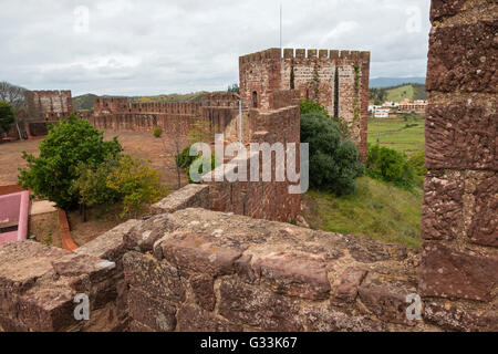 Walls of medieval castle in Silves town, Algarve region, Portugal - Stock Photo