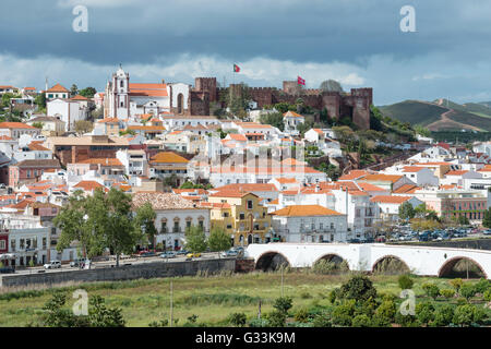 SILVES, PORTUGAL - APRIL 11, 2016 - Silves town buildings with famous castle and cathedral, Algarve region, Portugal - Stock Photo