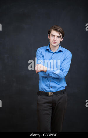 Portrait of a man in front of a chalkboard - Stock Photo