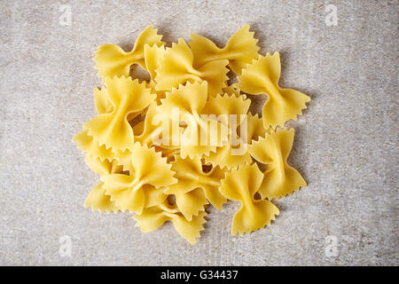 Bow tie pasta on stone table, top view - Stock Photo