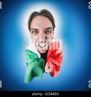 Italian soccer Fan holding the flag of Italy excited and happy for his team - Stock Photo