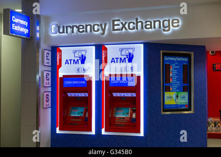 ATM s / automatic teller machine machines at Bureau de Change office operated by Travelex at London City Airport. - Stock Photo