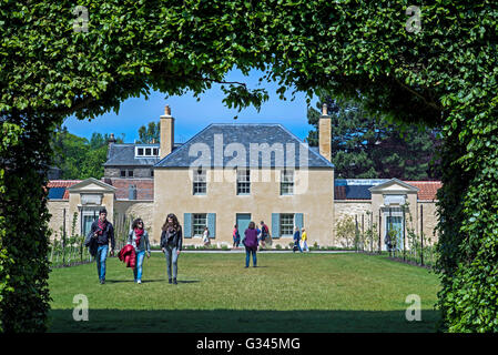 The view through the beech hedge looking towards the newly restored Botanic Cottage in the Botanic Gardens in Edinburgh. - Stock Photo