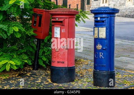 Red postage stamp machine and post box marked EIIR, old blue airmail pillar box marked GR, Windsor, Berkshire,England - Stock Photo