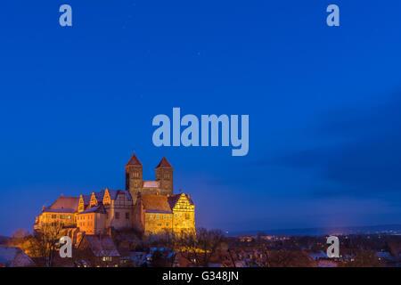 Castle of Quedlinburg at dusk, Germany - Stock Photo