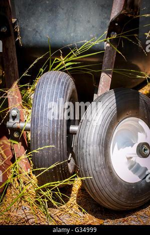A new tire for an old wheelbarrow - Stock Photo