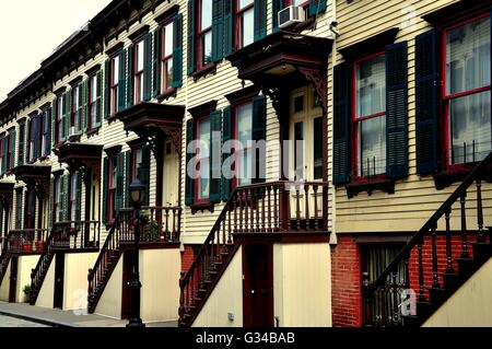 New York City:  Sylvan Terrace 1882 wooden row houses with distinctive stoops in the Morris-Jumel Historic District - Stock Photo