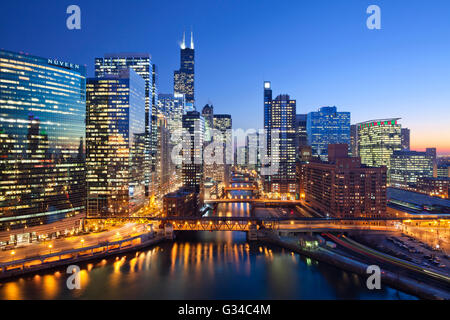 City of Chicago. Image of Chicago downtown and Chicago River with bridges during sunset. - Stock Photo